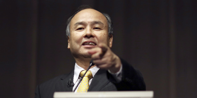 FILE - In this Nov. 4, 2014 file photo, SoftBank founder and Chief Executive Officer Masayoshi Son speaks during a news conference in Tokyo. Japanese Internet company SoftBank Group Corp., which is struggling to turn around Sprint in the U.S., is reporting a 27 percent drop in profit for the fiscal year ended March 31, compared to the previous year. (AP Photo/Eugene Hoshiko, File)