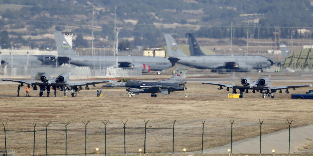 A Turkish Air Force F-16 fighter jet ( C foreground) is seen between U.S. Air Force A-10 Thunderbolt II fighter jets at Incirlik airbase in the southern city of Adana, Turkey, December 11, 2015. REUTERS/Umit Bektas