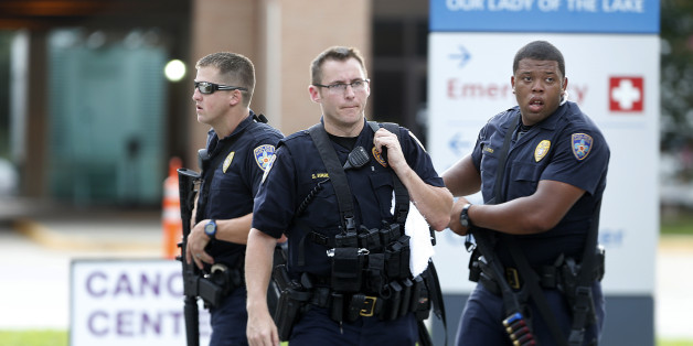Police guard the emergency room entrance of Our Lady Of The Lake Medical Center, where wounded officers were brought, in Baton Rouge, La., Sunday, July 17, 2016. Multiple law enforcement officers were killed and wounded Sunday morning in a shooting near a gas station in Baton Rouge, less than two weeks after a black man was shot and killed by police here, sparking nightly protests across the city. (AP Photo/Gerald Herbert)