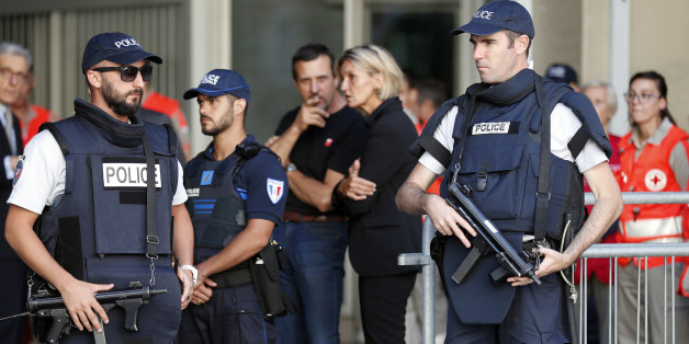 French Police stand in front of a Chapel of Rest to welcome families of victims, three days after a truck mowed through revelers, on the famed Promenade des Anglais in Nice, southern France, Sunday, July 17, 2016. French authorities detained two more people Sunday in the investigation into the Bastille Day truck attack on the Mediterranean city of Nice that killed at least 84 people, as authorities try to determine whether the slain attacker was a committed religious extremist or just a very ang