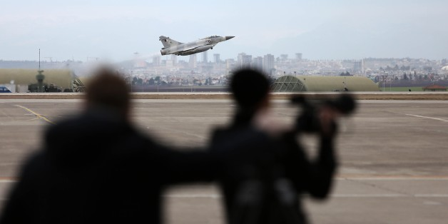 ADANA, TURKEY - JANUARY 21: A military plane take off as Turkish Defense Minister Ismet Yilmaz (not seen) and German Defence Minister Ursula Von Der Leyen (not seen) hold a press conference at Incirlik Air Base, in Adana, Turkey  on January 21, 2016. (Photo by Ibrahim Erikan/Anadolu Agency/Getty Images)