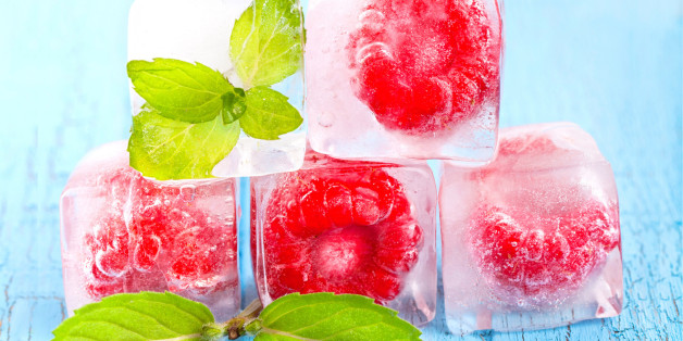 Ice cubes and raspberries with mint leafs
