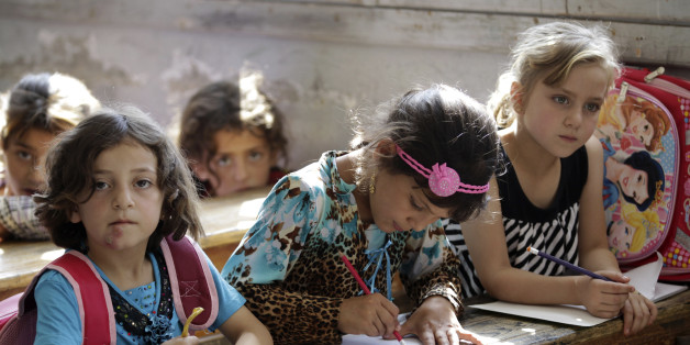 Girls attend a class at a school in southern countryside of Idlib, Syria, September 20, 2015. REUTERS/Khalil Ashawi