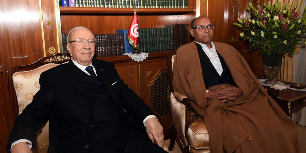 Tunisia's new President, Beji Caid Essebsi, left, poses in his office with out-going President, Moncef Marzouki, during a handover ceremony at the presidential palace in Carthahe outside Tunis, Tunisia, Wednesday, Dec. 31, 2014. Tunisia's new president pledged a rule of reconciliation and consensus as he took his oath Wednesday before the newly elected parliament to complete the country's democratic transition. The inauguration of Beji Caid Essebsi, an 88-year-old political veteran, comes in a year in which Tunisians wrote a new constitution and elected a new parliament and president, ending a transition kicked off by a revolution. (AP Photo)