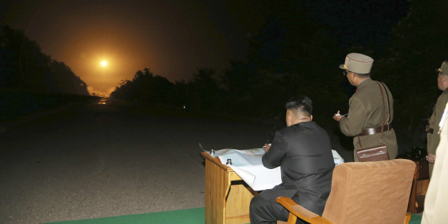 North Korean leader Kim Jong Un provides field guidance during a tactical rocket firing drill carried out by units of the Korean People's Army (KPA) Strategic Force in the western sector of the front in this undated photo released by North Korea's Korean Central News Agency (KCNA) in Pyongyang on July 10, 2014. REUTERS/KCNA (NORTH KOREA - Tags: POLITICS MILITARY) ATTENTION EDITORS ? THIS PICTURE WAS PROVIDED BY A THIRD PARTY. REUTERS IS UNABLE TO INDEPENDENTLY VERIFY THE AUTHENTICITY, CONTENT, L