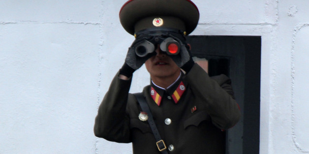 A North Korean soldier looks through binoculars on the Yalu River in Sinuiju, opposite the Chinese border city of Dandong, May 1, 2016. Picture taken from China's side of the Yalu. REUTERS/Jacky Chen