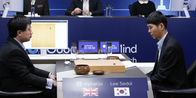 South Korean professional Go player Lee Sedol, right, prepares for his first stone against Google's artificial intelligence program, AlphaGo, as Google DeepMind's lead programmer Aja Huang, left, sits during the second match of the Google DeepMind Challenge Match in Seoul, South Korea, Thursday, March 10, 2016. Google's computer program AlphaGo defeated its human opponent, South Korean Go champion Lee Sedol, on Wednesday in the first face-off of a historic five-game match. (AP Photo/Lee Jin-man)