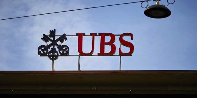 A photo taken on February 2, 2016 shows the logo of Swiss bank UBS on a building on Paradeplatz in Zurich.