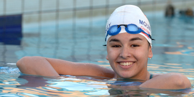 Libyan swimmer Daniah Hagul, 17, poses for a picture as she trains at the national pool in Msida, Malta, on July 15, 2016. Calm and composed, with an infectious smile, Daniah Hagul is heading to Rio with a heavy weight on her shoulders: she will be the first woman swimmer to represent Libya at the Olympics after the fall of longtime dictator Moamer Kadhafi. / AFP / Matthew Mirabelli        (Photo credit should read MATTHEW MIRABELLI/AFP/Getty Images)