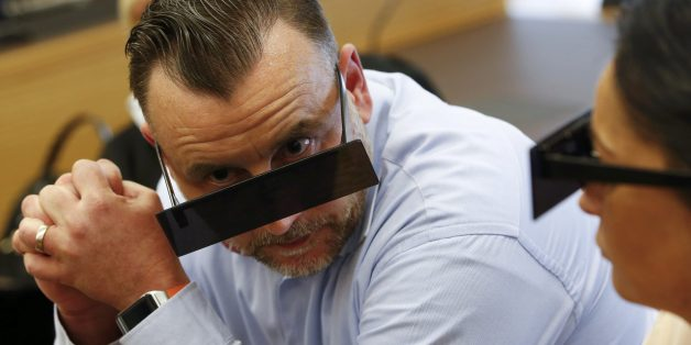 Lutz Bachmann, founder of Germany's xenophobic and anti-Islamic PEGIDA movement (Patriotic Europeans Against the Islamisation of the Occident), has his eyes covered as if pixelized by media in a courtroom on April 19, 2016 in Dresden, eastern Germany, at the start of his trial.Lutz Bachmann has to appear in court on hate speech charges for branding refugees 'cattle' and 'scum' on social media. He was charged in October 2015 with inciting racial hatred through a series of widely-shared Facebook p