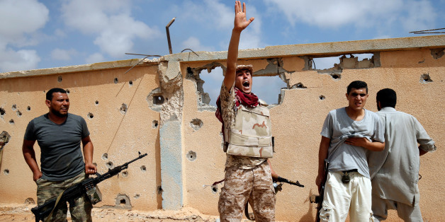 A member of Libyan forces allied with the U.N.-backed government gestures during a battle with Islamic State fighters in Sirte, Libya, July 15, 2016. REUTERS/Goran Tomasevic