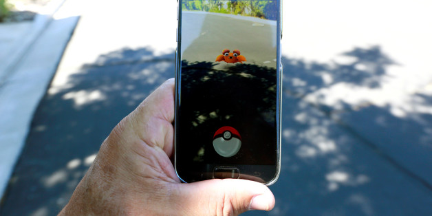"""The augmented reality mobile game """"Pokemon Go"""" by Nintendo is shown on a smartphone screen in this photo illustration taken in Palm Springs, California U.S. July 11, 2016.  REUTERS/Sam Mircovich/Illustration"""