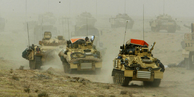 A British army armoured vehicle convoy rolls into southern Iraq March 22, 2003. Picture taken March 22, 2003. REUTERS/Oleg Popov/File Photo
