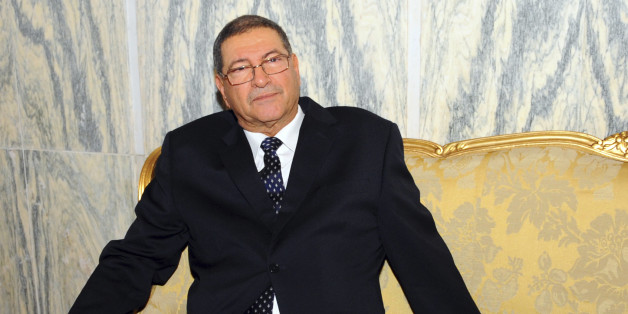 Habib Essid, 65, sits in a sofa before being asked by the newly elected president to form a coalition and name a Cabinet over the next month, Monday, Jan.5, 2015 in Tunis. Tunisia's largest political party chose a veteran from the country's former dictatorship as its candidate for prime minister Monday and he began work immediately on forming a coalition government. (AP Photo/Hassene Dridi)