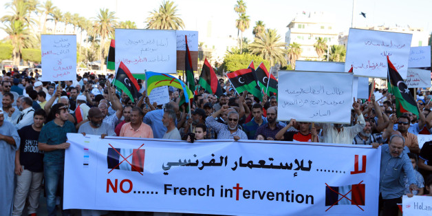 Libyan protesters hold banners and placards during a demonstration to protest against the French military intervention in the country on July 20, 2016 on Martyrs' Square in the capital Tripoli.Three French soldiers were killed during a mission to gather intelligence in Libya, President Francois Hollande said in the first official confirmation that France has troops in the country where IS controls a key city. / AFP / STRINGER        (Photo credit should read STRINGER/AFP/Getty Images)
