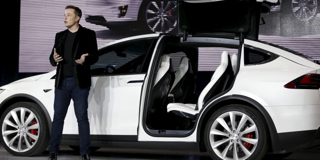 Tesla Motors CEO Elon Musk introduces the falcon wing door on the Model X electric sports-utility vehicles during a presentation in Fremont, California September 29, 2015. Tesla Motors delivered the first of its long-awaited Model X electric sports-utility vehicles on Tuesday, a product investors are counting on to make the pioneering company profitable after years of losses. REUTERS/Stephen Lam