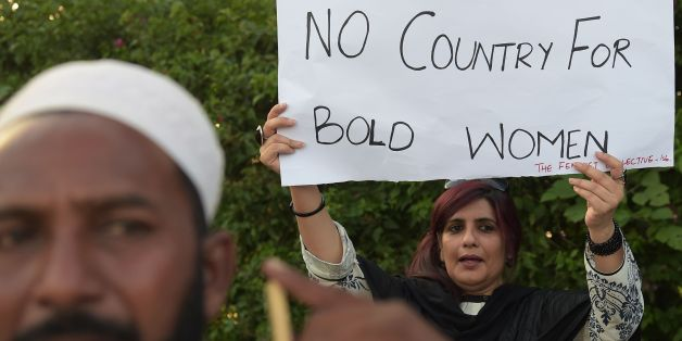 An Pakistani civil society activist carries a placard during a protest in Islamabad on July 18, 2016 against the murder of social media celebrity Qandeel Baloch by her own brother.The brother of a murdered Pakistani celebrity said he is 'not embarrassed' to have killed her, as Qandeel Baloch's death reignited polarising calls for action against the 'epidemic' of honour killings. The strangling of Baloch, judged by many in deeply conservative Muslim Pakistan as infamous for selfies and videos tha