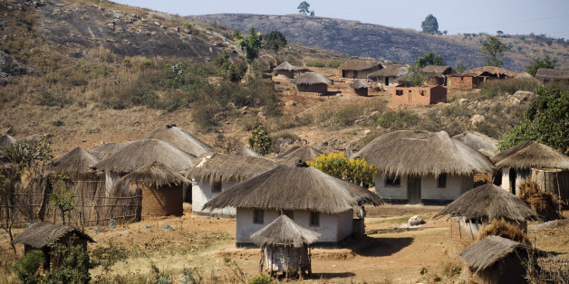 'Malawi, Dedza.  Grass roofed houses in a rural village in the Dedza region.'