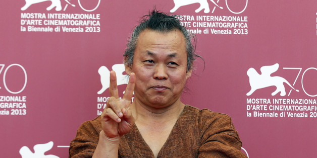 "Director Kim Ki-duk poses during a photocall for his movie ""Moebius"" during the 70th Venice Film Festival in Venice September 3, 2013. The movie debuts at the festival. REUTERS/Alessandro Bianchi (ITALY - Tags: ENTERTAINMENT)"
