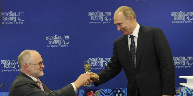 Russia's President Vladimir Putin (R) toasts with President of the International Paralympic Committee Philip Craven before the opening ceremony of the 2014 Paralympic Winter Games in Sochi, March 7, 2014. REUTERS/Mikhail Klimentyev/RIA Novosti/Kremlin (RUSSIA  - Tags: POLITICS OLYMPICS SPORT) ATTENTION EDITORS - THIS IMAGE HAS BEEN SUPPLIED BY A THIRD PARTY. IT IS DISTRIBUTED, EXACTLY AS RECEIVED BY REUTERS, AS A SERVICE TO CLIENTS