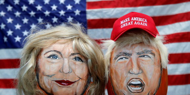 The images of U.S. Democratic presidential candidate Hillary Clinton (L) and Republican Presidential candidate Donald Trump are seen painted on decorative pumpkins created by artist John Kettman in LaSalle, Illinois, U.S., June 8, 2016.     REUTERS/Jim Young      TPX IMAGES OF THE DAY