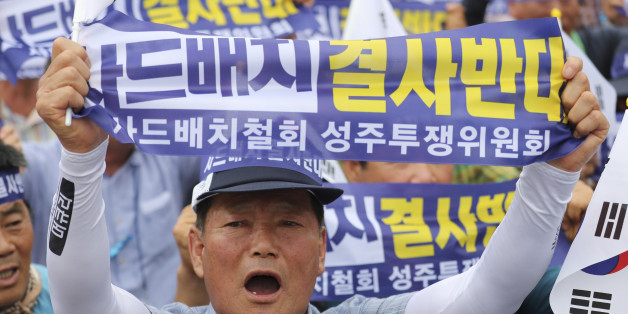 A resident in a rural South Korean town shouts slogans protesting a plan to deploy an advanced U.S. missile defense system called Terminal High-Altitude Area Defense, or THAAD, in their neighborhood, in Seoul, South Korea, Thursday, July 21, 2016. The missile system will be deployed in southeastern South Korea, Seoul officials announced Wednesday, July 13, angering not only North Korea and China but also local residents who fear potential health hazards they believe the U.S. system might cause.