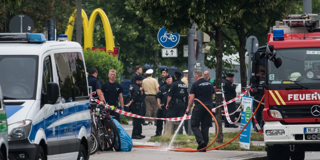 MUNICH, GERMANY - JULY 23: Police and fire services clean the area the shooting occured outside the OEZ shopping center, the day after a shooting spree left nine victims dead on July 23, 2016 in Munich, Germany. According to police an 18-year-old German man of Iranian descent shot nine people dead and wounded at least 16 before he shot himself in a nearby park. For hours during the spree and the following manhunt the city lay paralyzed as police ordered people to stay off the streets. Original r