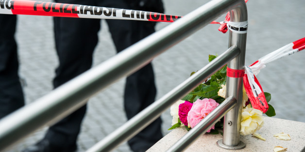 MUNICH, GERMANY - JULY 23: Flowers layed by people outside the OEZ shopping center the day after a shooting spree left nine victims dead on July 23, 2016 in Munich, Germany. According to police an 18-year-old German man of Iranian descent shot nine people dead and wounded at least 16 before he shot himself in a nearby park. For hours during the spree and the following manhunt the city lay paralyzed as police ordered people to stay off the streets. Original reports of up to three attackers seem t