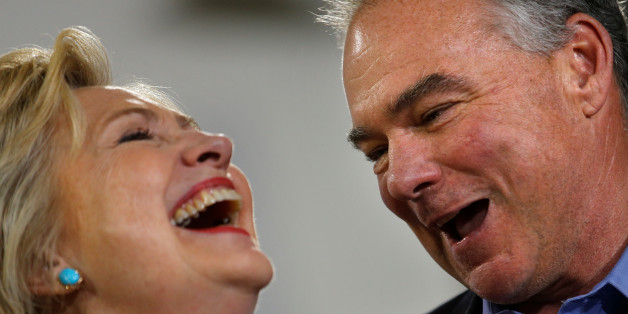 Democratic U.S. presidential candidate Hillary Clinton and U.S. Senator Tim Kaine (D-VA) react during a campaign rally at Ernst Community Cultural Center in Annandale, Virginia, U.S., July 14, 2016.  REUTERS/Carlos Barria