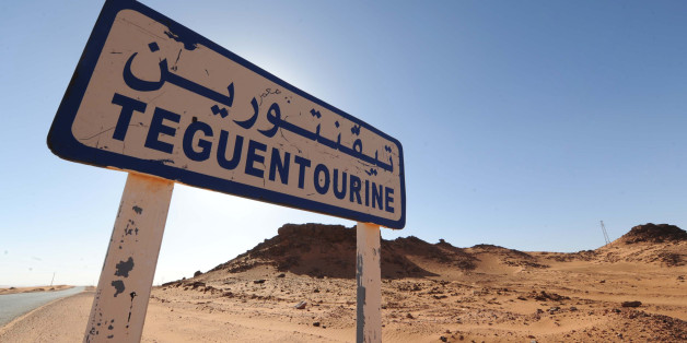 A picture shows a road sign indicating Tiguentourine near In Amenas on a road leading to a gas complex where Islamist gunmen had taken hostages in the desert in Algeria's deep south on January 19, 2013. Islamist gunmen killed seven foreign hostages in Algeria before being gunned down by special forces in a final assault on a remote desert gas complex, state television said. The 11 heavily armed men from a group known as 'Signatories in Blood' had been holed up at the In Amenas complex since they