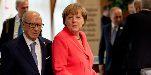 German chancellor Angela Merkel , right,  and Tunisia's  President Beji Caid Essebsi.  wait prior to a working session at   the  G-7 summit at Schloss Elmau hotel near Garmisch-Partenkirchen, southern Germany, Monday June 8, 2015. (Sven Hoppe/Pool Photo via AP)