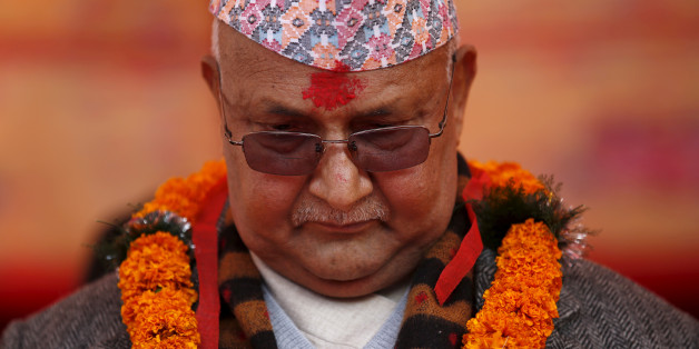 Nepal's Prime Minister Khadga Prasad Sharma Oli, also known as K.P. Oli, observes a minute of silence for earthquake victims during an event organised to mark the 18th National Earthquake Safety Day and the official launch of earthquake reconstruction efforts in Bungamati village, Nepal January 16, 2016. REUTERS/Navesh Chitrakar/File photo