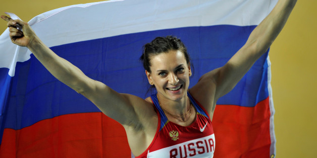 Gold medalist Elena Isinbayeva of Russia holds her national flag after the women's pole vault final during the world indoor athletics championships at the Atakoy Athletics Arena in Istanbul March 11, 2012. Isinbayeva won the gold medal with 4,80 metres, ahead of Bosiak who won silver and Bleasdale who won bronze. REUTERS/Dylan Martinez/File Photo