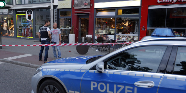 Police patrol outside where a 21-year-old Syrian refugee killed a woman with a machete and injured two other people in the city of Reutlingen, Germany July 24, 2016. REUTERS/Vincent Kessler