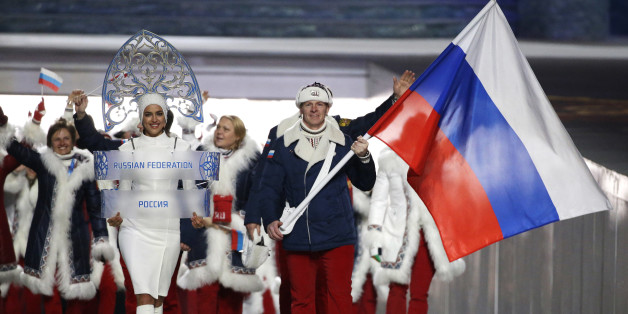FILE - In this Feb. 7, 2014 file photo Alexander Zubkov of Russia carries the national flag as he leads the team during the opening ceremony of the 2014 Winter Olympics in Sochi, Russia.  On Monday, July 18, 2016 a report on Russian doping by investigator Richard McLaren is to be released in Toronto.   (AP Photo/Mark Humphrey, file)