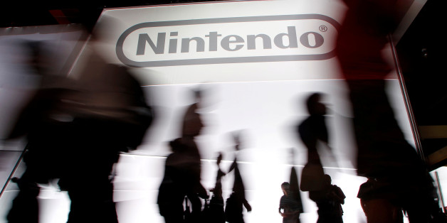 Attendees walk past the Nintendo of America Inc. booth during the Electronic Entertainment Expo or E3 in Los Angeles June 7, 2011. REUTERS/Danny Moloshok/File Photo