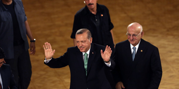 Turkey's President Recep Tayyip Erdogan salutes after his address at the parliament in Ankara, Turkey, Friday, July 22, 2016. Parliament voted 346-115 to approve the national state of emergency, which gives sweeping new powers to President Recep Tayyip Erdogan, who had been accused of autocratic conduct even before this week's crackdown on alleged opponents. Erdogan has said the state of emergency will counter threats to Turkish democracy. (AP Photo/Burhan Ozbilici)