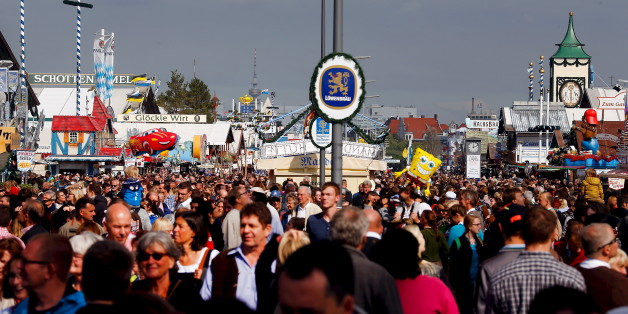 A general view shows visitors during the 182nd Oktoberfest in Munich September 27, 2015. Millions of beer drinkers from around the world will come to the Bavarian capital for the Oktoberfest, which runs until October 4, 2015. REUTERS/Michael Dalder