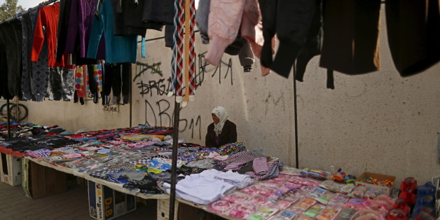 "Meriem, 60, a street vendor, sits as she waits for customers in Kasserine, where young people have been demonstrating for jobs since last week, January 30, 2016. ""I am not pleased at all by the political and economic situation of Tunisia. There is a lack of security, money, jobs; the poverty has clearly been on the rise since the 2011 revolution. I wish, we can go back to the time before the revolution,"" Meriem said.  REUTERS/Zohra Bensemra"