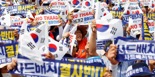 "Seoungju residents chant slogans during a protest against the government's decision on deploying a U.S. THAAD anti-missile defense unit in Seongju, in Seoul, South Korea, July 21, 2016. The banner reads ""Desperately oppose deploying THAAD"".  REUTERS/Kim Hong-Ji"