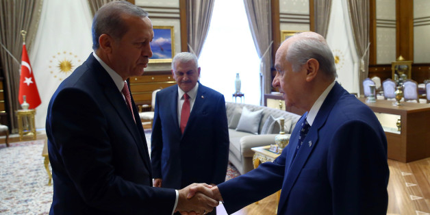 Turkey's President Recep Tayyip Erdoganl left, greets Devlet Bahceli before a meeting in Ankara, Turkey, Monday, July 25, 2016. Erdogan met Monday with leaders of the main opposition parties, Republican People's Party leader Kemal Kilicdaroglu, National Movement Party leader Devlet Bahceli and Turkish Prime Minister Binali Yildirim. The meeting took place amid a government crackdown upon people suspected of links with Fethullah Gulen, a self-exiled cleric that Erdogan blames for the failed coup