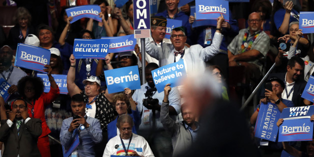 Supporters cheer as former Democratic Presidential candidate, Sen. Bernie Sanders, I-Vt., speaks during the first day of the Democratic National Convention in Philadelphia, Monday, July 25, 2016. (AP Photo/Paul Sancya)