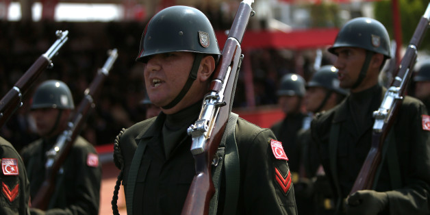 Turkish soldiers take part in the annual military parade, the highlight of celebrations marking the 42nd anniversary of the 1974 Turkish invasion, in the Turkish-controlled northern part of Nicosia in this ethnically divided island of Cyprus, on Wednesday, July 20, 2016. This year's parade was a muted affair with neither warplanes nor heavy battle tanks making an appearance following a decision by Turkish Cypriot leaders and army commanders to keep celebrations low key in the wake of the failed