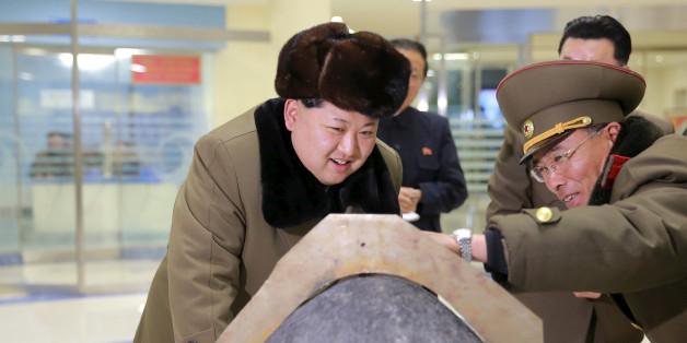 FILE PHOTO: North Korean leader Kim Jong Un looks at a rocket warhead tip after a simulated test of atmospheric re-entry of a ballistic missile, at an unidentified location in this undated photo released by North Korea's Korean Central News Agency (KCNA) in Pyongyang on March 15, 2016.     REUTERS/KCNA ATTENTION EDITORS - THIS PICTURE WAS PROVIDED BY A THIRD PARTY. REUTERS IS UNABLE TO INDEPENDENTLY VERIFY THE AUTHENTICITY, CONTENT, LOCATION OR DATE OF THIS IMAGE. FOR EDITORIAL USE ONLY. NOT FOR