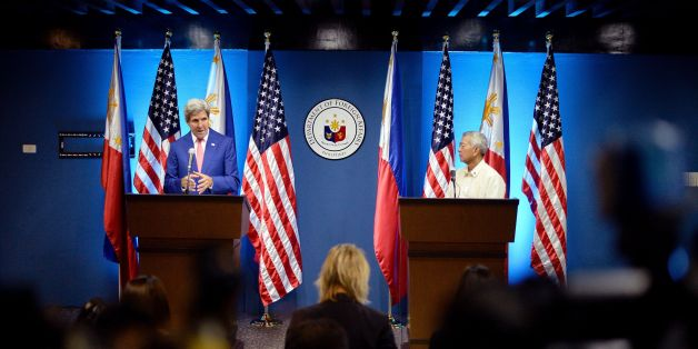 US Secretary of State John Kerry (L) speaks during a joint press conference with Philippine Foreign Secretary Perfecto Yasay (R) at the Department of Foreign Affairs building in Manila on July 27, 2016.Kerry arrived in Manila for a two-day visit after attending the Association of Southeast Asian Nations (ASEAN) meeting in Laos. / AFP / NOEL CELIS        (Photo credit should read NOEL CELIS/AFP/Getty Images)