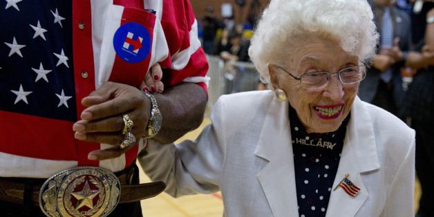 John Goodie escorts 101-year-old Jerry Emmett, of Prescott, Ariz., a supporter of Democratic presidential candidate Hillary Clinton, to her seat before Clinton arrives to speak at a campaign event at Carl Hayden Community High School in Phoenix on Monday, March 21, 2016. (AP Photo/Carolyn Kaster)