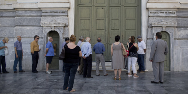 Athens residents wait for a branch of the National Bank of Greece to open in central Athens on Tuesday, June 28, 2016. Greece introduced capital controls for bank transactions a year ago amid financial turmoil triggered by bailout negotiation delays. Country residents can still withdraw a maximum of 420 euros (around $465) a week. (AP Photo/Petros Giannakouris)
