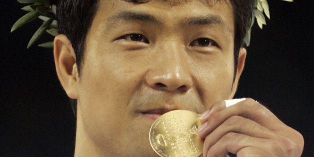 Dae Sung Moon, from Korea, displays his gold medal after defeating Alexandros Nilolaidis, from Greece, with a technical knockout in men's over 80kg taekwondo at the 2004 Olympic Games in Athens, Greece, Sunday, Aug. 29, 2004. (AP Photo/Al Behrman)