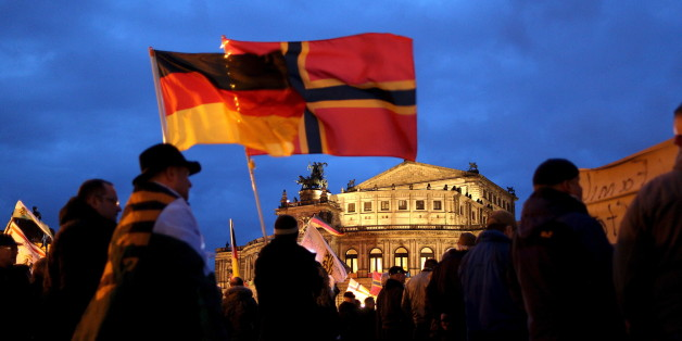 """Supporters of the anti-Islam movement """"Patriotic Europeans Against the Islamisation of the West"""" (PEGIDA) wave flags during a demonstration in Dresden, Germany, March 21, 2016. REUTERS/Ina Fassbender"""