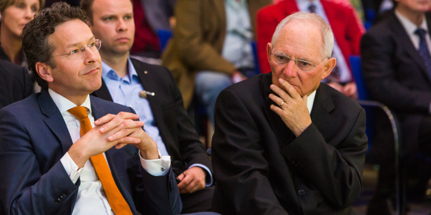 Jeroen Dijsselbloem, Dutch finance minister and head of the group of euro-area finance ministers, left, and Wolfgang Schaeuble, Germany's finance minister, wait for the start of a news conference at the finance ministry in Berlin, Germany, on Monday, April 4, 2016. Greece could again face the threat of being pushed into default and out of the euro if its current bailout review drags on into June and July, according to European officials monitoring the slow progress of Prime Minister Alexis Tsipras's negotiations with creditors. Photographer: Rolf Schulten/Bloomberg via Getty Images